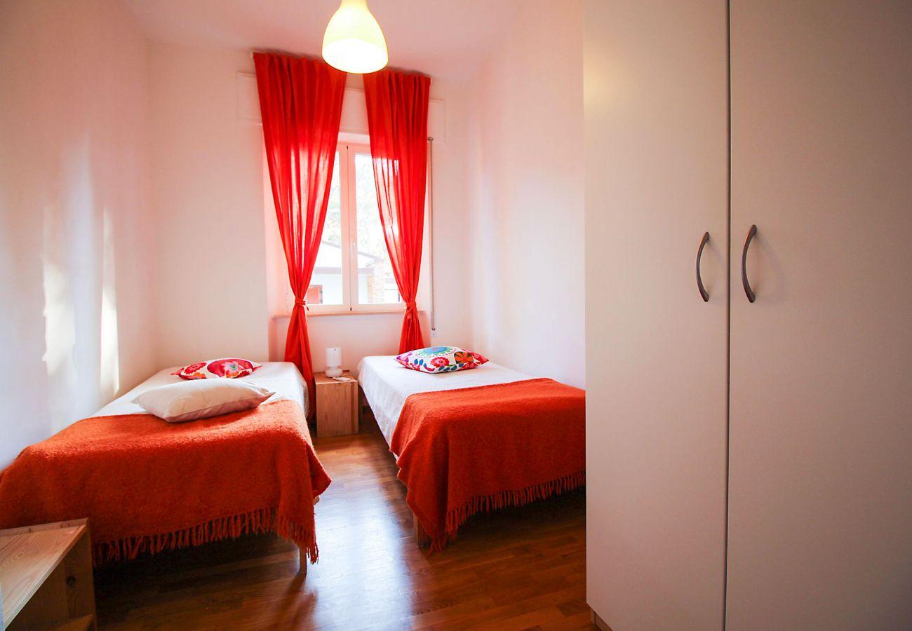 Marina di Grosseto-Wohnung Lavanda-Das Schlafzimmer mit zwei Betten