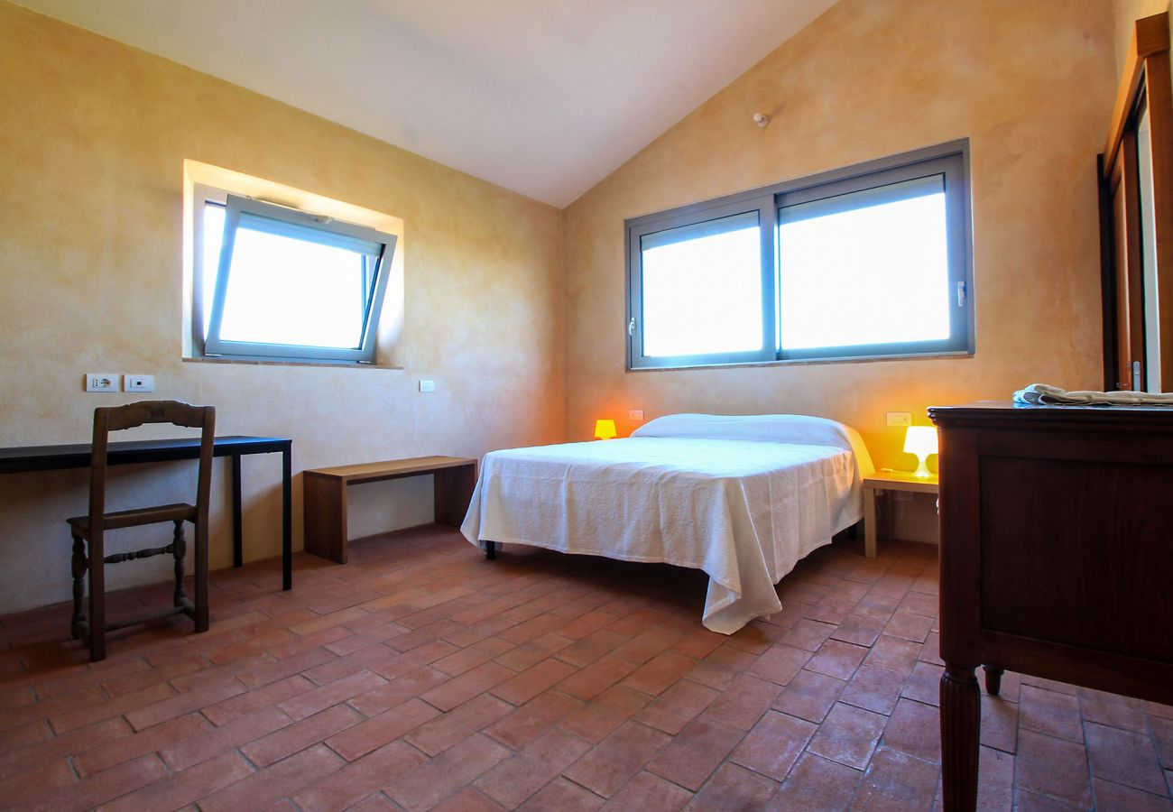 One of the beautiful double bedrooms of the Casa La Centurina in Tuscany